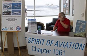 Tracy manning the Chapter information table in the Stead Terminal lobby.