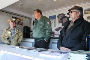 Greg, Steve and Bill working in the merchandise trailer.