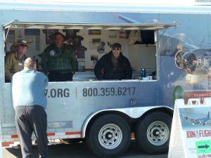 Greg, Steve and Bill manning the EAA merchandise trailer.
