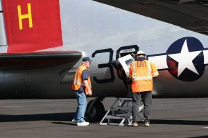 Mike and Randy helping passengers deplane after their flight.