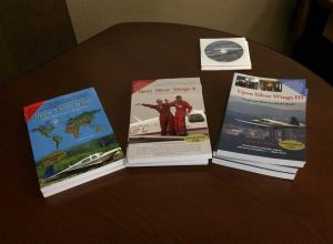 Books written by CarolAnn describing her around the world flight experiences.