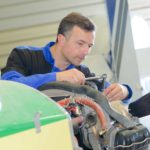 Mechanic doing engine maintenance