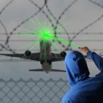 Illegally shining laser at an aircraft